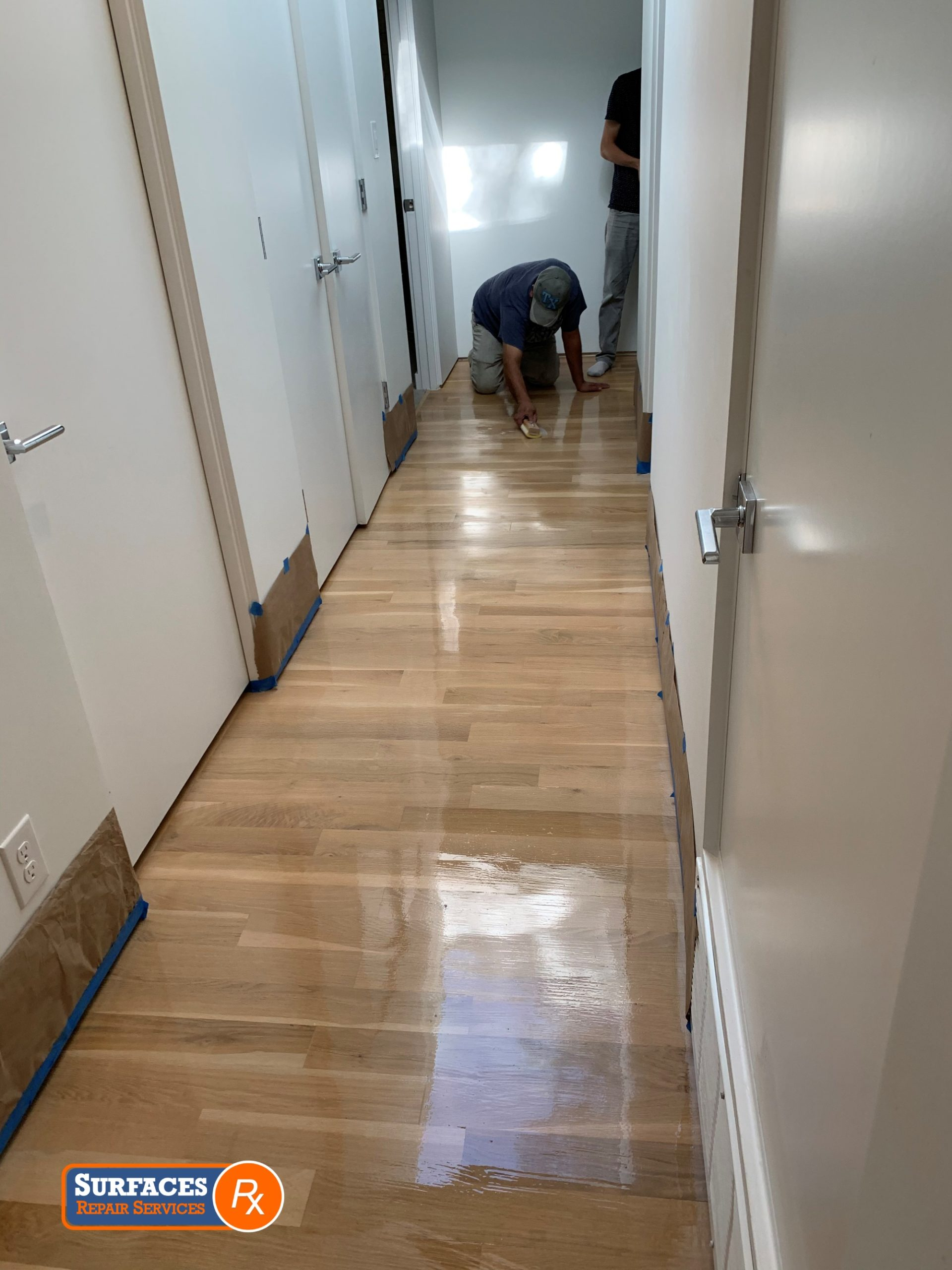 Applying Waterborne Top Coat Finish After Repairing Scratch Dallas Hardwood Floor