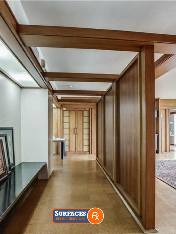 Oak paneled hallway in condo 3525 Condominiums Texas Before Surfaces Rx Millwork Refinishing